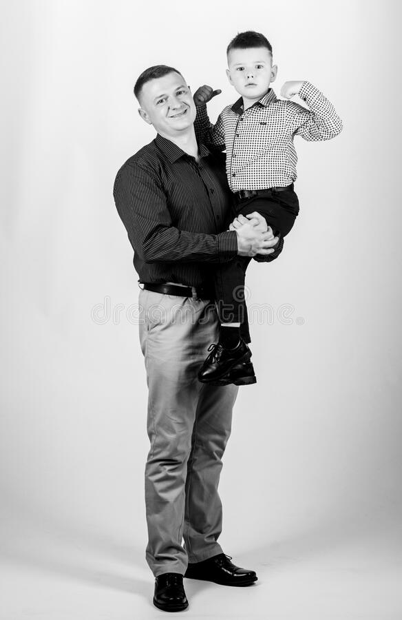 Dad and adorable child. Parenthood concept. Fathers day. Father example of noble human. Family bonds. Family support. Real men. Trustful relations father and royalty free stock images