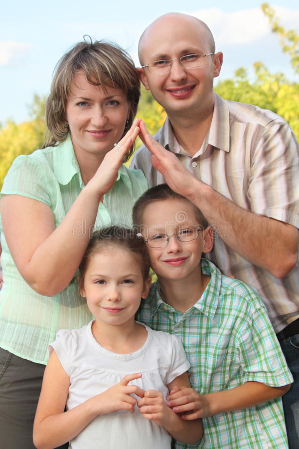 Free Dad And Mom Is Using Hands To Represent Home Stock Photography - 13020952