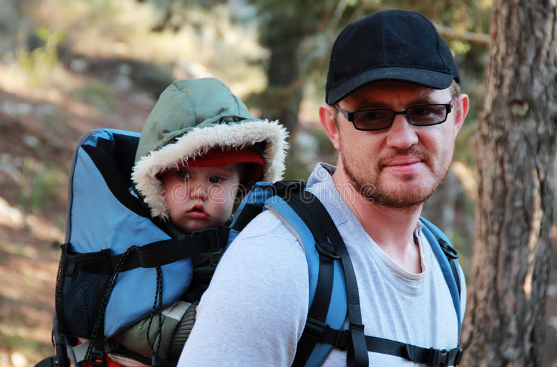 Dad with a baby. Dad and Child in Baby Hiking stock photo