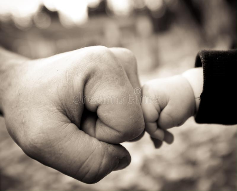Dad and baby fist bump. Dad and infants fist bump