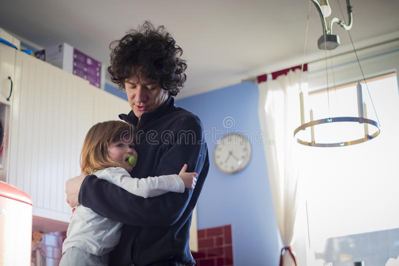 Dad and baby girl embracing at home stock photos