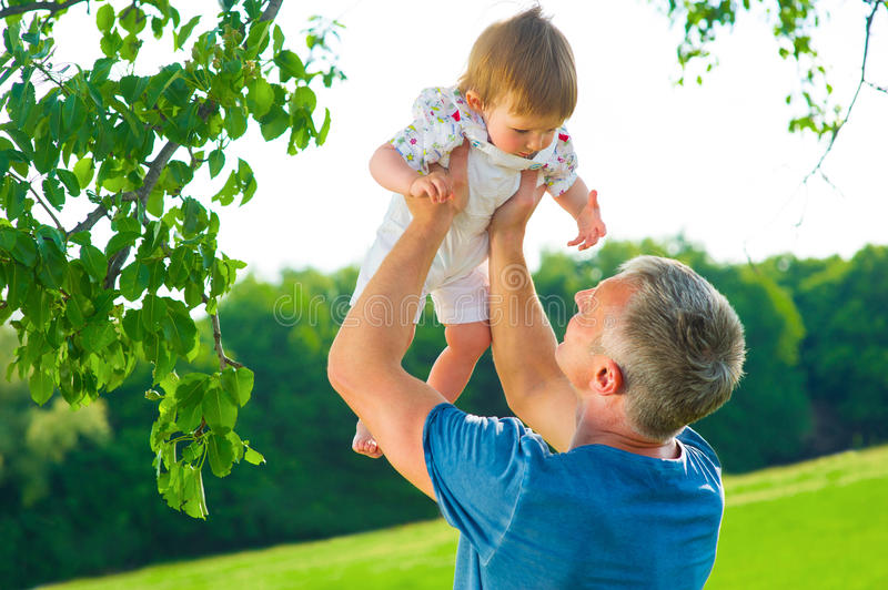 Dad with a baby outdoors. stock photography