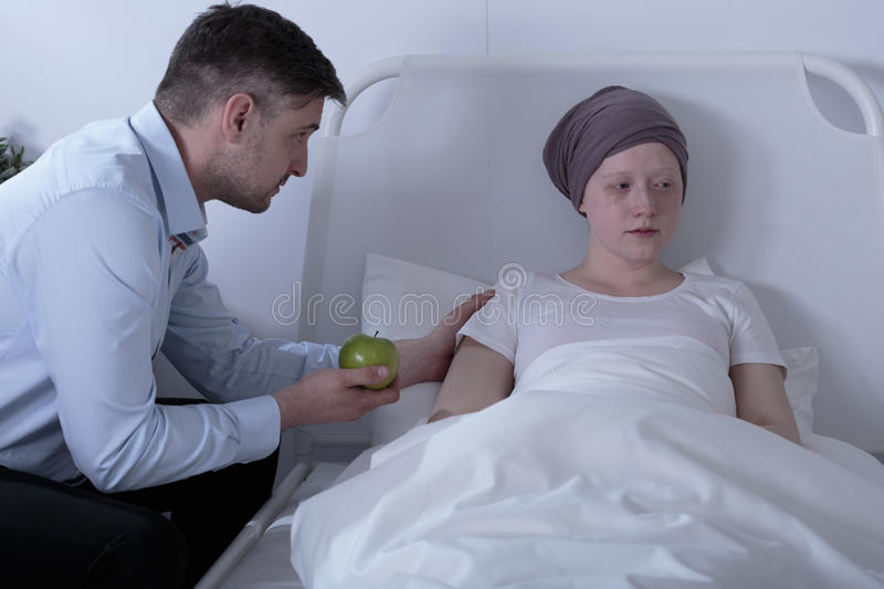 Dad caring about ill daughter. Having leukemia stock photo