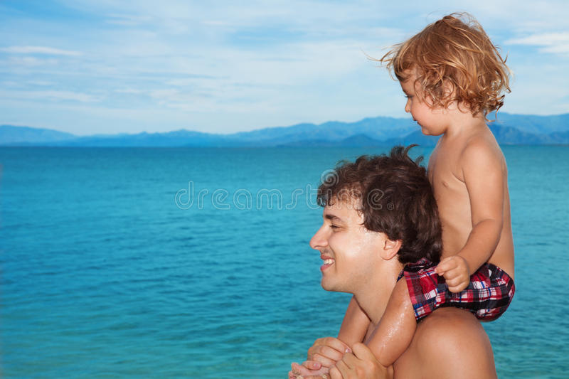 Download Dad carry kid on shoulders stock image. Image of beach - 25227691