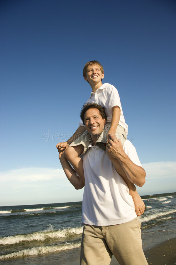 Dad carrying son royalty free stock photos