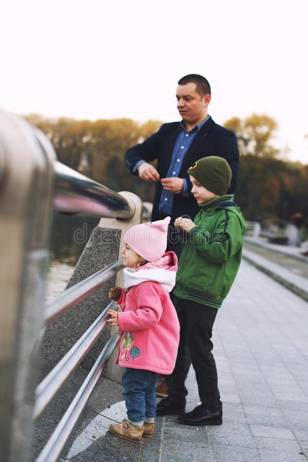 Dad with children walks in the park royalty free stock photography