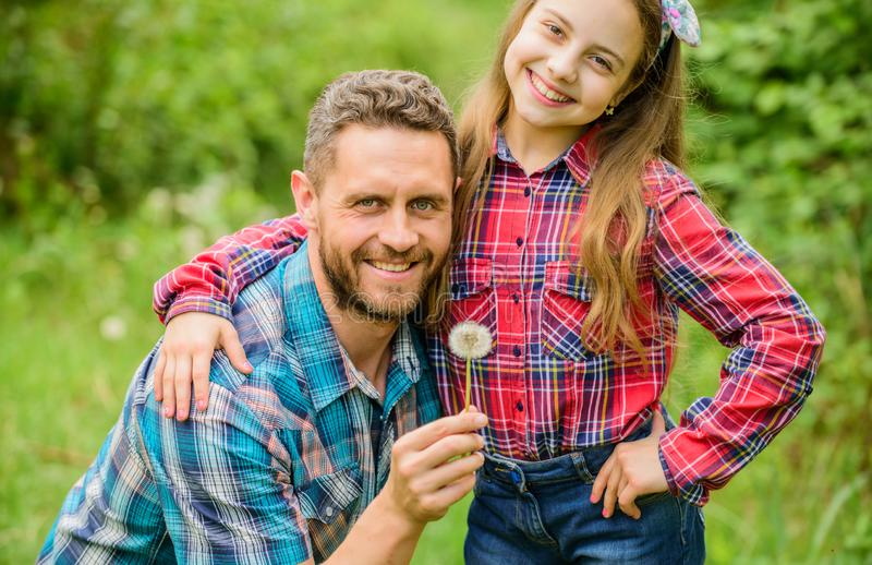 Dad and daughter blowing dandelion seeds. Keep allergies from ruining your life. Seasonal allergies concept. Outgrow. Allergies. Biggest pollen allergy stock photo