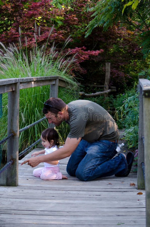 Download Dad And Daughter On A Bridge Stock Photo - Image: 26445788