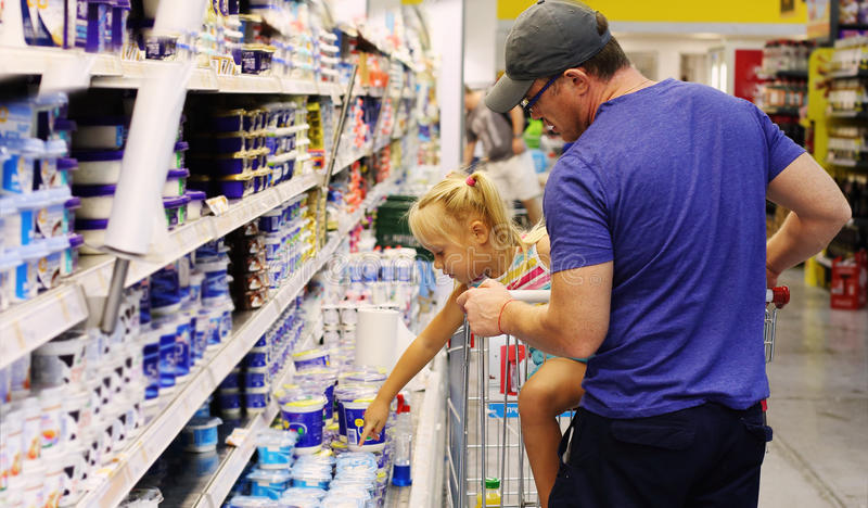 Dad and daughter. Buying food in the supermarket