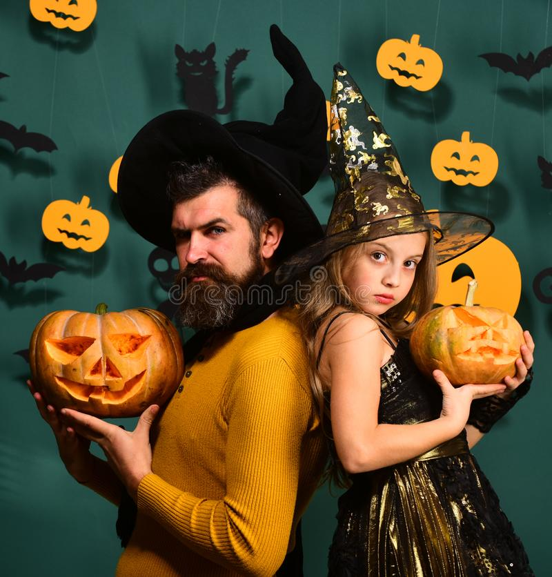 Dad and daughter in costumes. Halloween party and holiday concept. stock photography