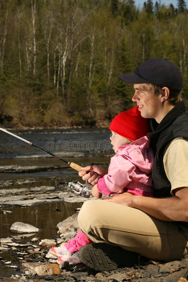 Dad and daughter fishing royalty free stock photography