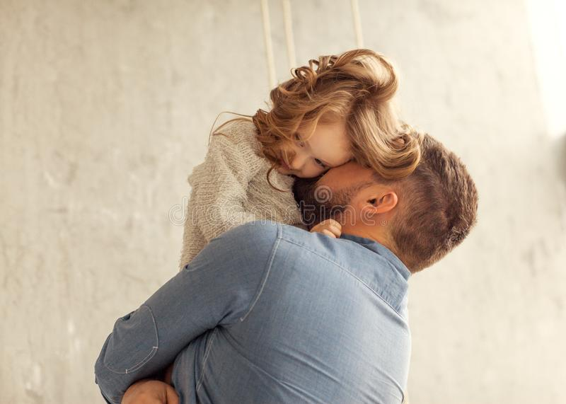 Dad and daughter are hugging at home royalty free stock image