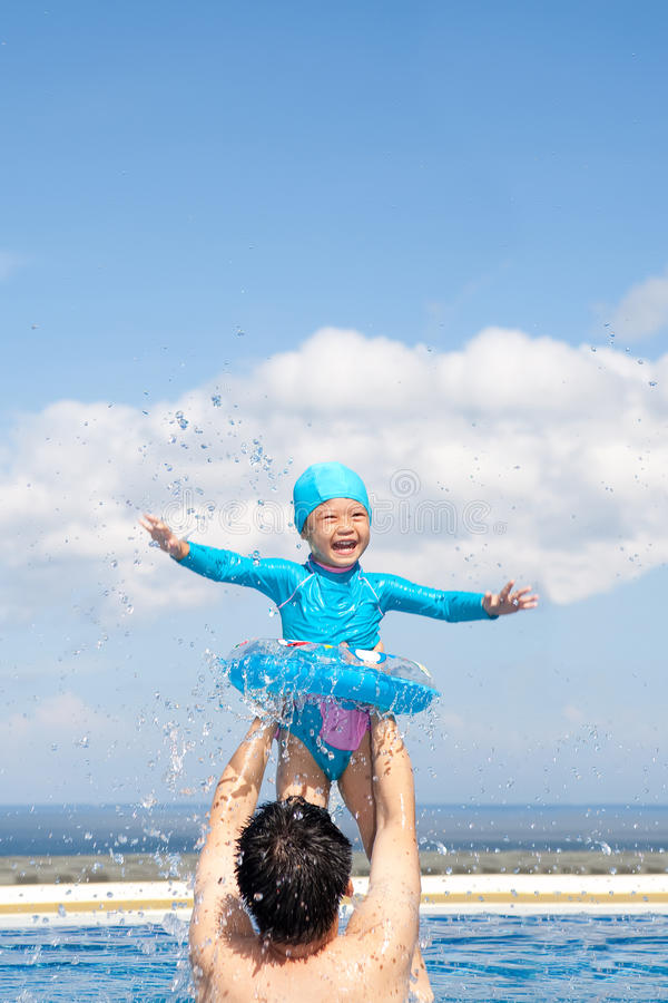 Download Dad And Daughter Playing In Swimming Pool Stock Photo - Image: 33407962