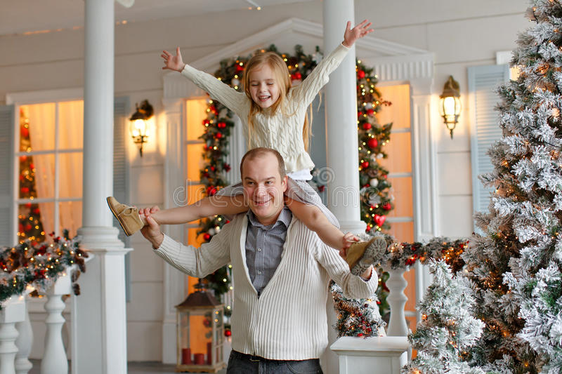 Dad and daughter smiling happily against the background of New Y royalty free stock image