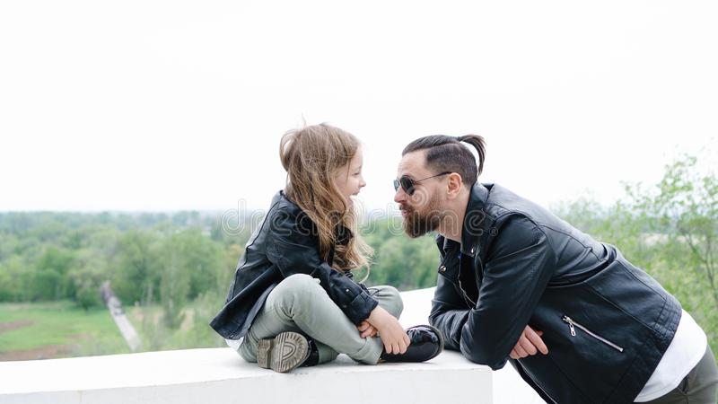 Dad and daughter walk around the city stock photography