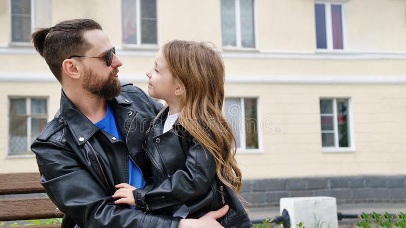Dad and daughter walk around the city royalty free stock photography