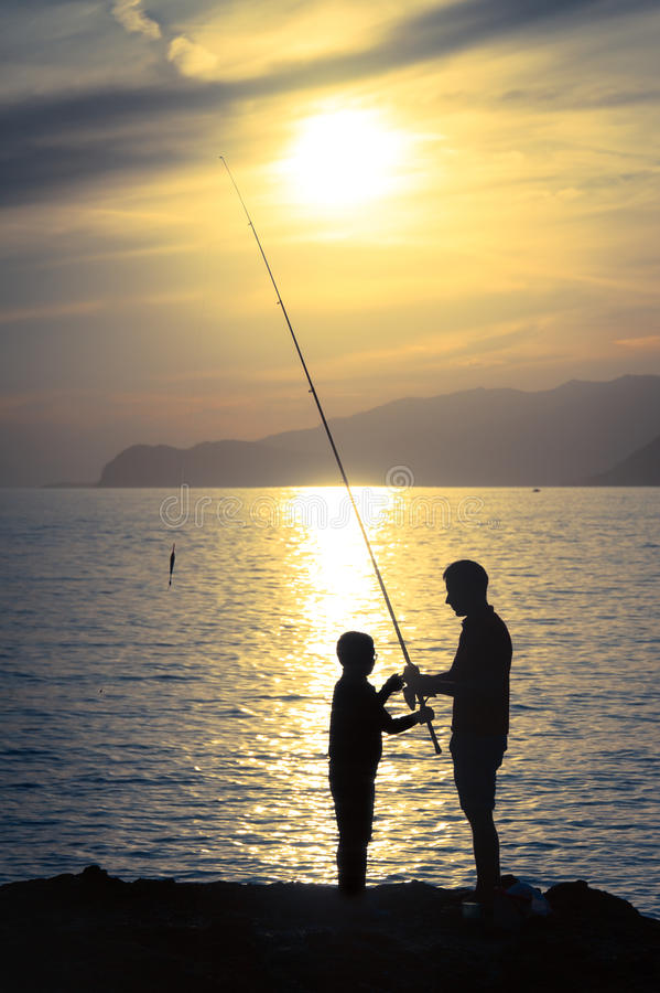 Download Dad and fishing teacher stock image. Image of passing - 33444149