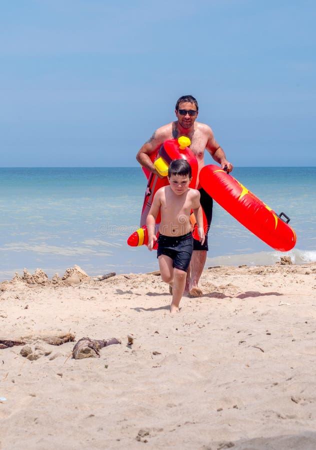 Upset, wet boy on beach royalty free stock photography
