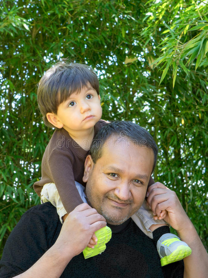 Dad Gives Son Ride On Shoulders stock images