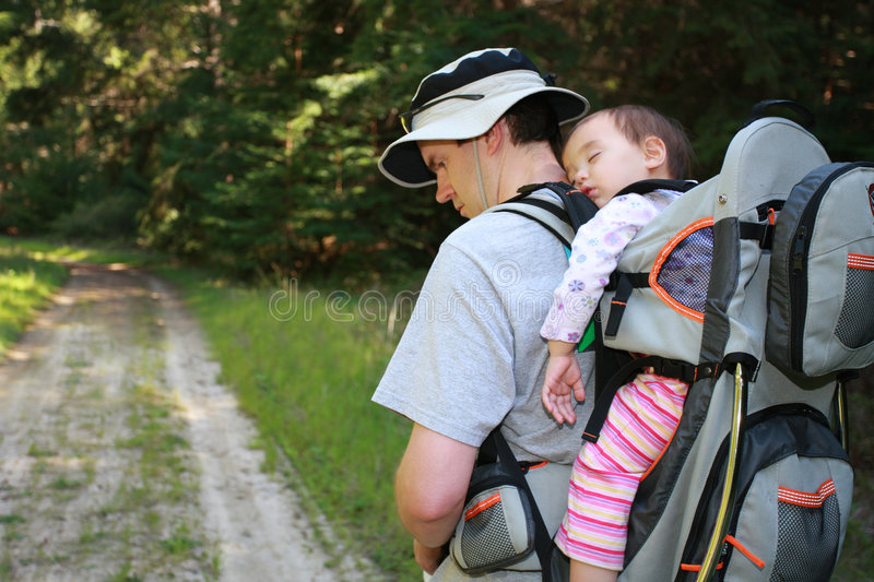 Dad hiking with baby girl stock photos