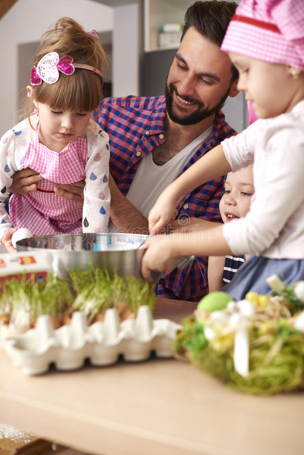 Dad with his baby girls before Easter stock photography
