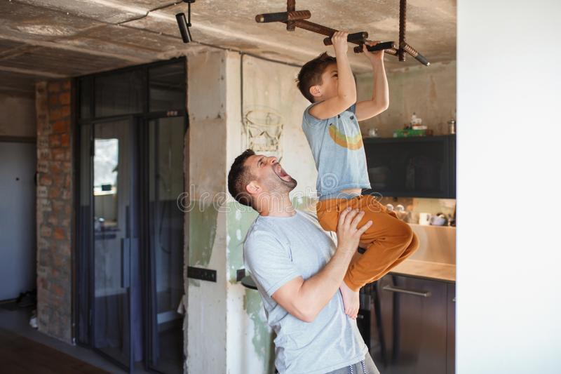 Dad and his little son play sports together royalty free stock photo