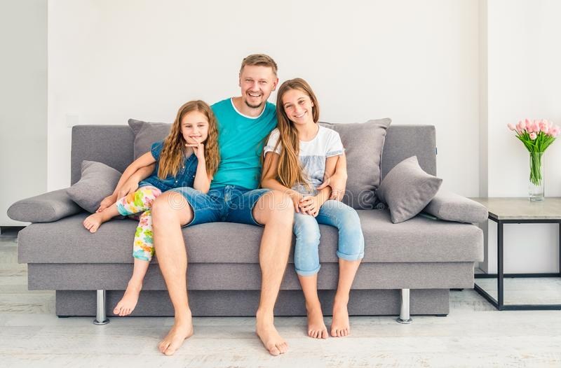 Dad and his two smiling daughters stock photos