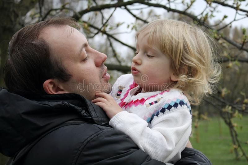 Download Dad Keeps Daughter In Her Arms Stock Photo - Image of father, happy: 13850350