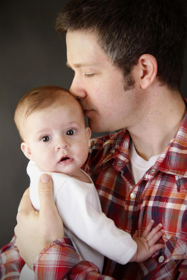 Download Dad kissing baby stock photo. Image of attractive, infant - 20676524