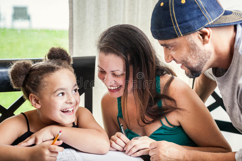Download Dad, Mom And Daughter Homework Stock Image - Image: 27022621