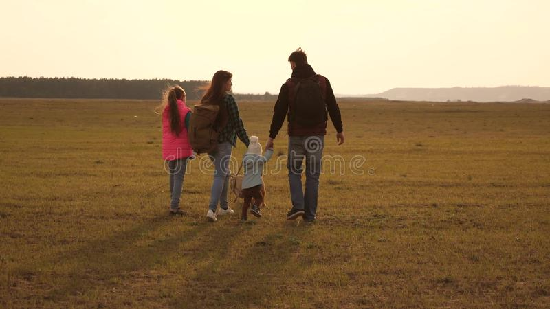 Dad, mom, daughters and pets, tourists. teamwork of a close-knit family. the family travels with the dog across the. Dad, mom, daughters and pets, tourists royalty free stock image