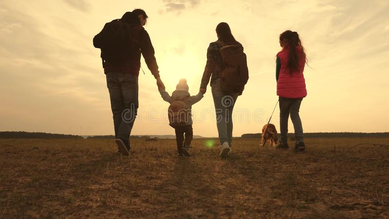 Dad, Mom, a small child and daughters and pets tourists. teamwork of a close-knit family. family travels with the dog on. Dad, Mom, small child and daughters and royalty free stock photography