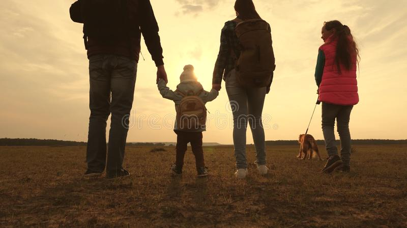 Dad, Mom, a small child and daughters and pets tourists. teamwork of a close-knit family. family travels with the dog on. Dad, Mom, small child and daughters and royalty free stock image
