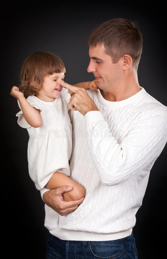 Dad plays with daughter stock photo