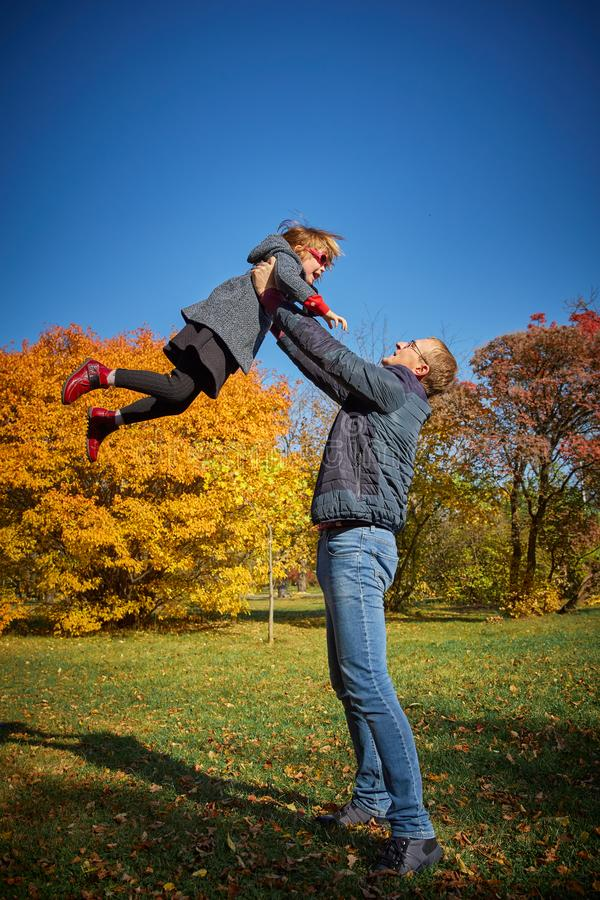 Dad plays with his daughter stock image