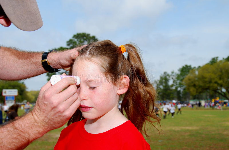 Dad Putting Sunscreen on Daughter royalty free stock image