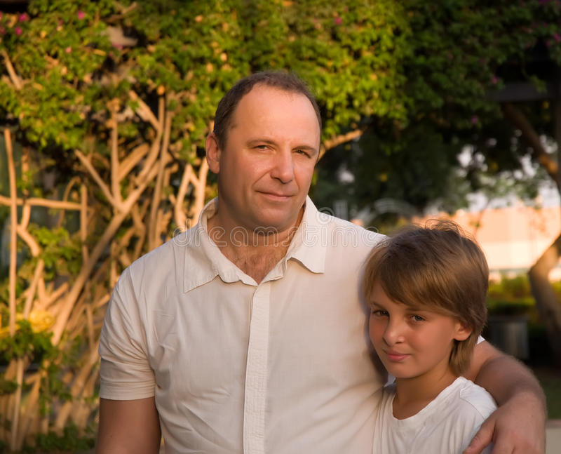 Dad and son . Happy dad with son in a park stock images