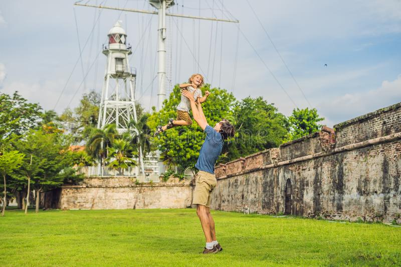 Dad and son on background of Fort Cornwallis in Georgetown, Pena. Ng, is a star fort built by the British East India Company in the late 18th century, it is the stock images