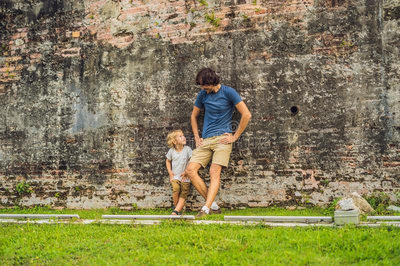 Dad and son on background of Fort Cornwallis in Georgetown, Penang, is a star fort built by the British East India Company in the. Late 18th century, it is the royalty free stock photos