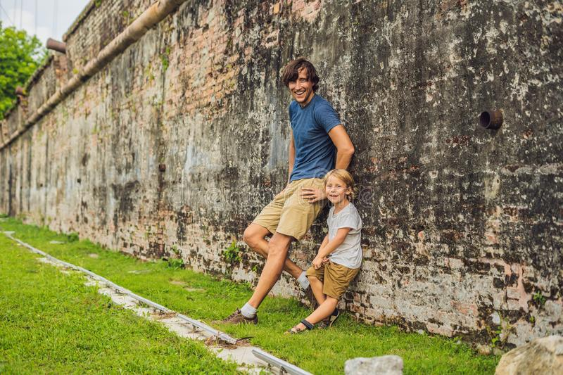 Dad and son on background of Fort Cornwallis in Georgetown, Penang, is a star fort built by the British East India Company in the. Late 18th century, it is the royalty free stock images