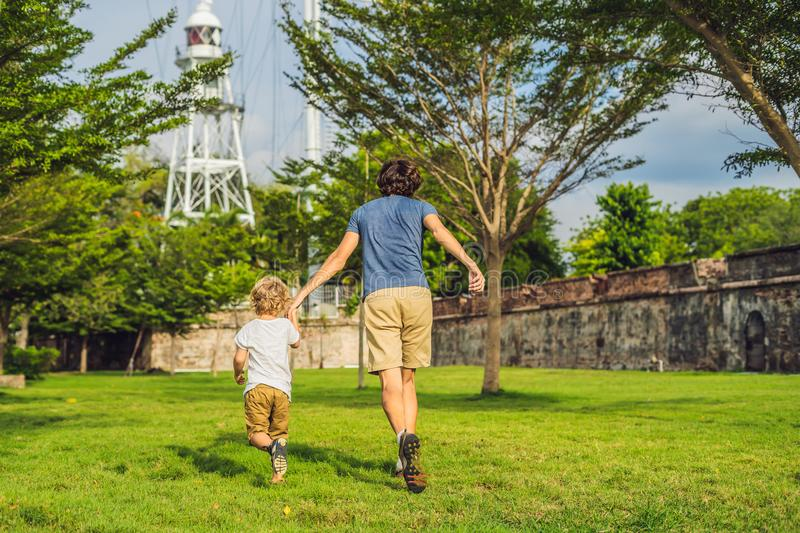 Dad and son on background of Fort Cornwallis in Georgetown, Penang, is a star fort built by the British East India Company in the. Late 18th century, it is the royalty free stock photography