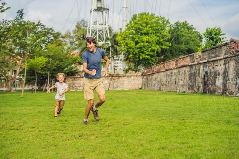 Dad and son on background of Fort Cornwallis in Georgetown, Penang, is a star fort built by the British East India Company in the. Late 18th century, it is the stock images