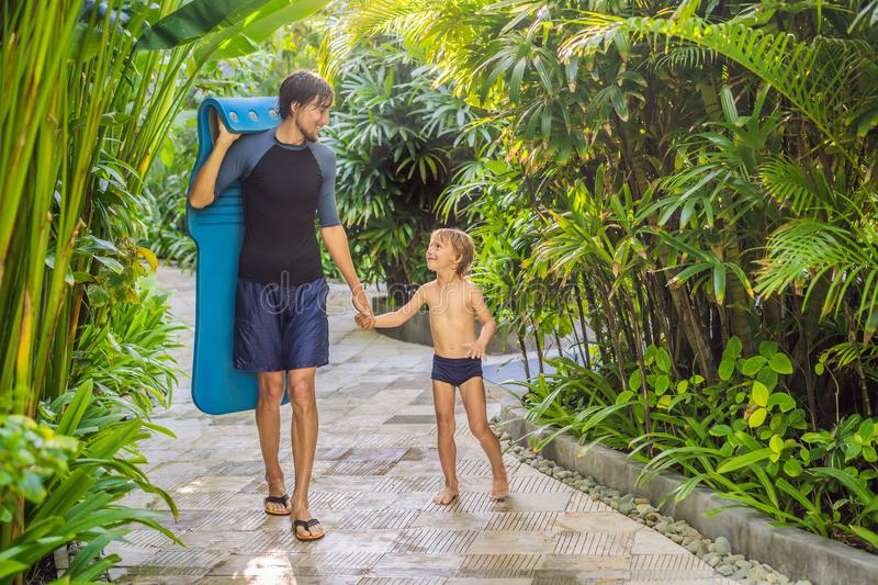Dad and son have fun at the water park stock images