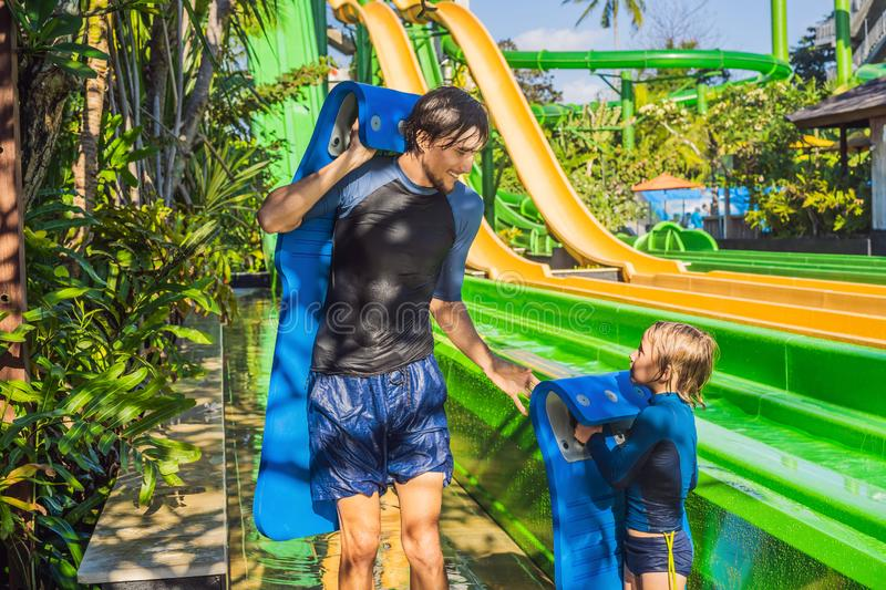 Dad and son have fun at the water park stock photo
