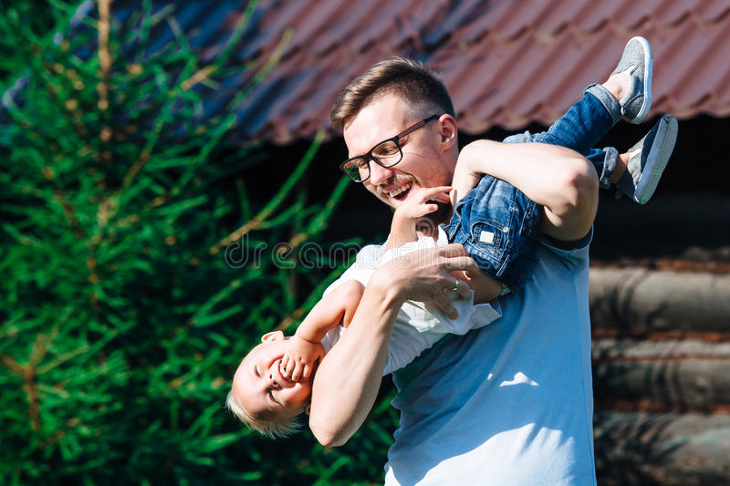 Dad and son having fun in the garden royalty free stock photo