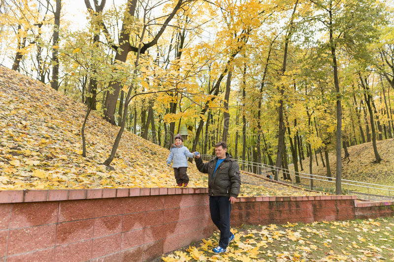 Dad and son in the park in autumn.  royalty free stock photos