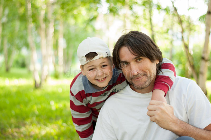 Dad and son at the park in summer. Dad and son at the park during the summer stock image