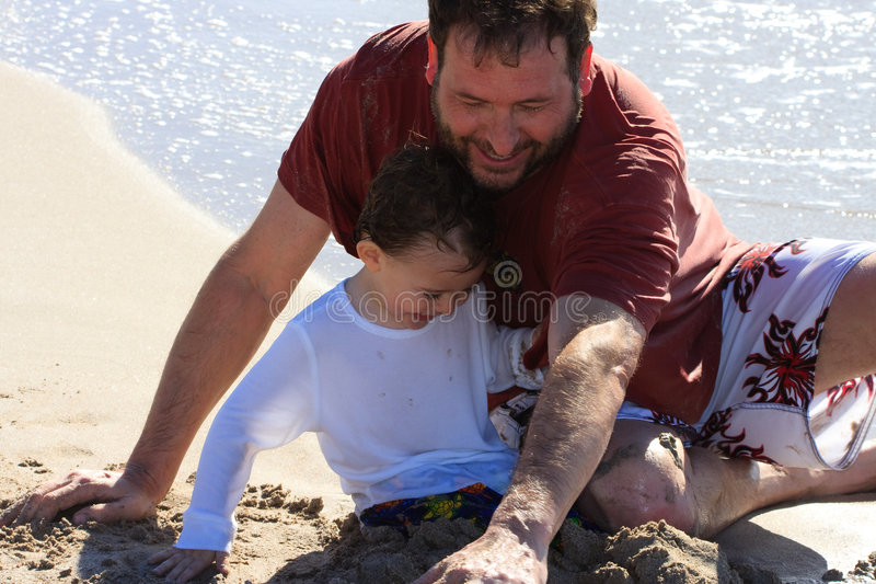 Download Dad And Son Playing At The Beach Stock Image - Image: 7972759