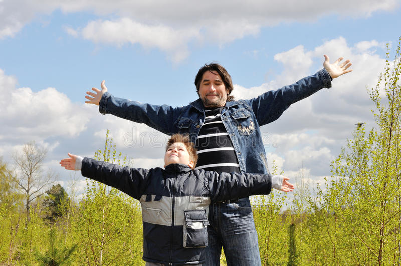 Download Dad And Son Relaxing Outdoor Royalty Free Stock Photo - Image: 24561665
