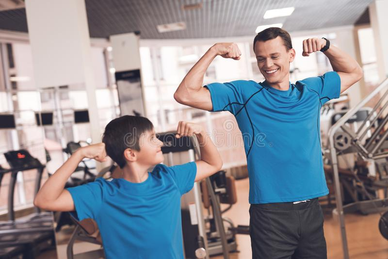 Dad and son in the same clothes in gym. Father and son lead a healthy lifestyle. stock images